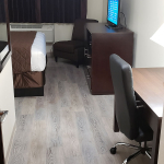 one king bed room amenities including TV and work desk